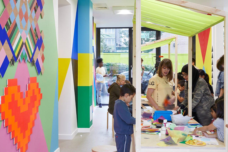 CHildren inside the artist's multi-coloured installation.