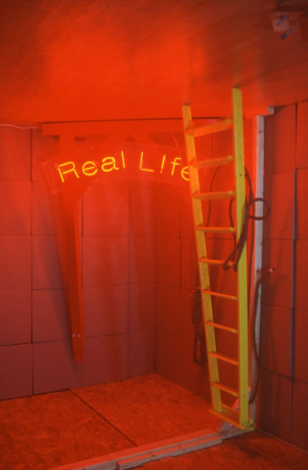Installation view of Ross Sinclair's 2001 exhibition Fortress Real Life (Peckham).