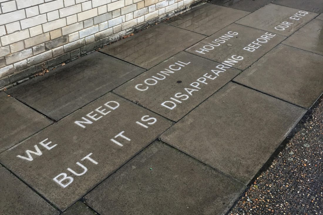 <p>Jessie Brennan, <em>We need council housing but it is disappearing before our eyes</em>, 2017, text in water-repellent spray, (words by Susan), temporarily sited on Pelican Estate. Photo: Jessie Brennan</p>