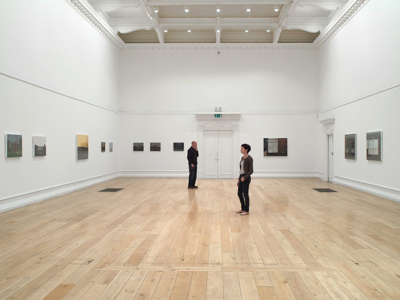 People visiting George Shaw's 2011 exhibition The Sly and Unseen Day in the Main Galleries. Photo: Andy Keate