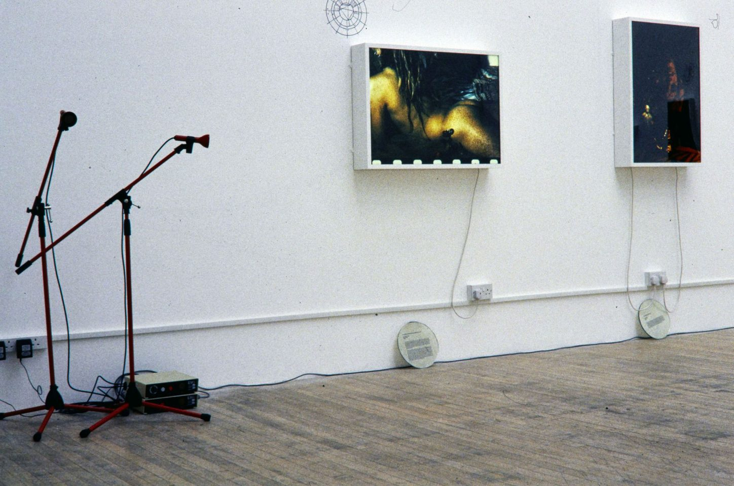 Installation view from Shaheen Merali's 1994 exhibtion Channels, Echoes and Empty Chairs