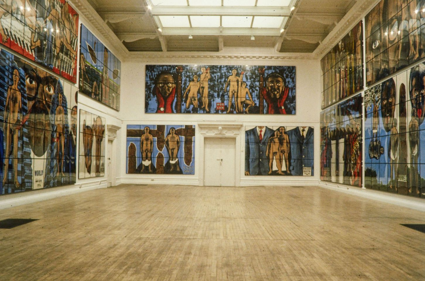 Installation view of Gilbert & George's 1995 exhibition The Naked Shit Pictures (+ The Naked Shit Model)