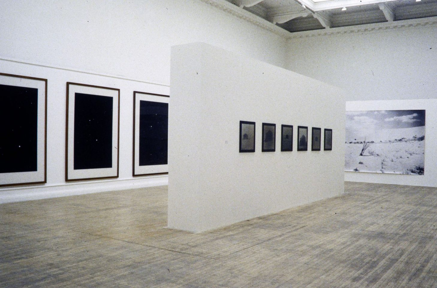 Installation view from 1997 exhibition Desert, featuring works by Hannah Collins, Knut Maron, Sophie Ristelhueber, Michael Rovner, Thomas Ruff, Frederick Sommer, Bill Viola, Verdi Yahooda. Curated by Jim Harold.