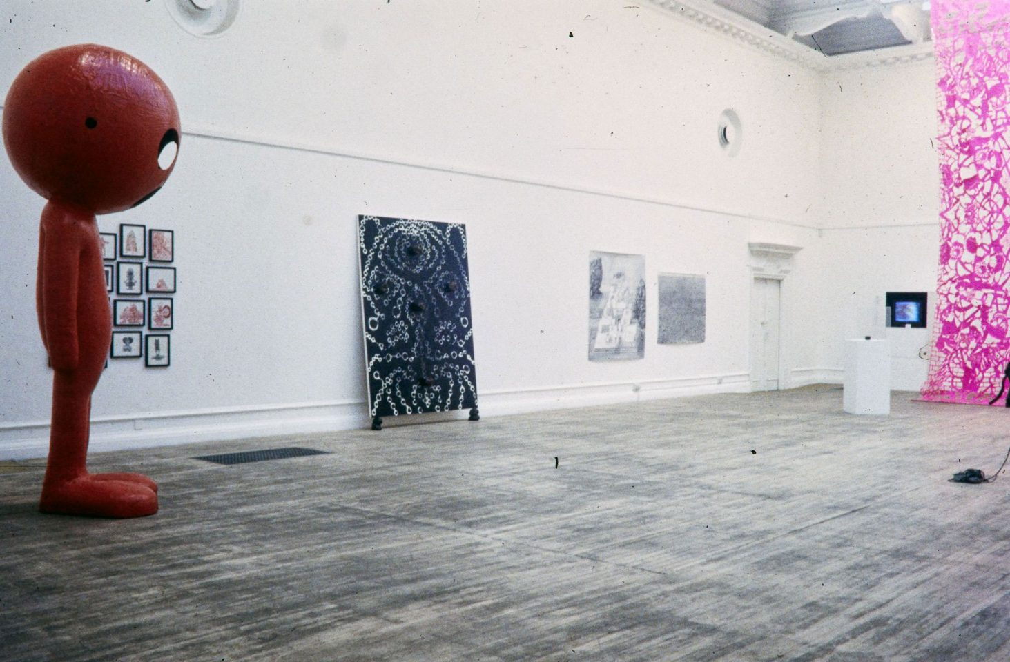 Installation view from 1996 exhibition Popoccultural featuring Simon Bill, Ellen Cantor, John Cussans & Ranu Mukherjee, Jeremy Deller, Cosey Fanni Tutti & Chris Carter, Jason Fox, Dan Graham, Paul McCarthy, Paul Noble, Chris Ofili, Simon Periton, Jeffrey Vallance. Curated by Cabinet Gallery.