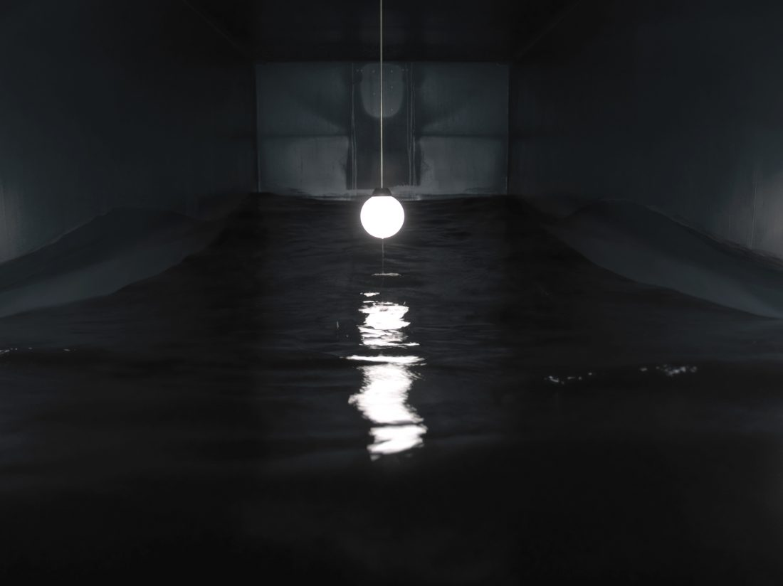 <p>Massimo Bartolini,<em> Sala para uma onda (Room for a wave)</em>, 2005-2007, shipping container, water, lamp, pump. Into a shipping container a wave goes on, covering and uncovering a ceiling globe lamp. Photo: A. Maranzano. Courtesy of the artist and Frith Street Gallery.</p>