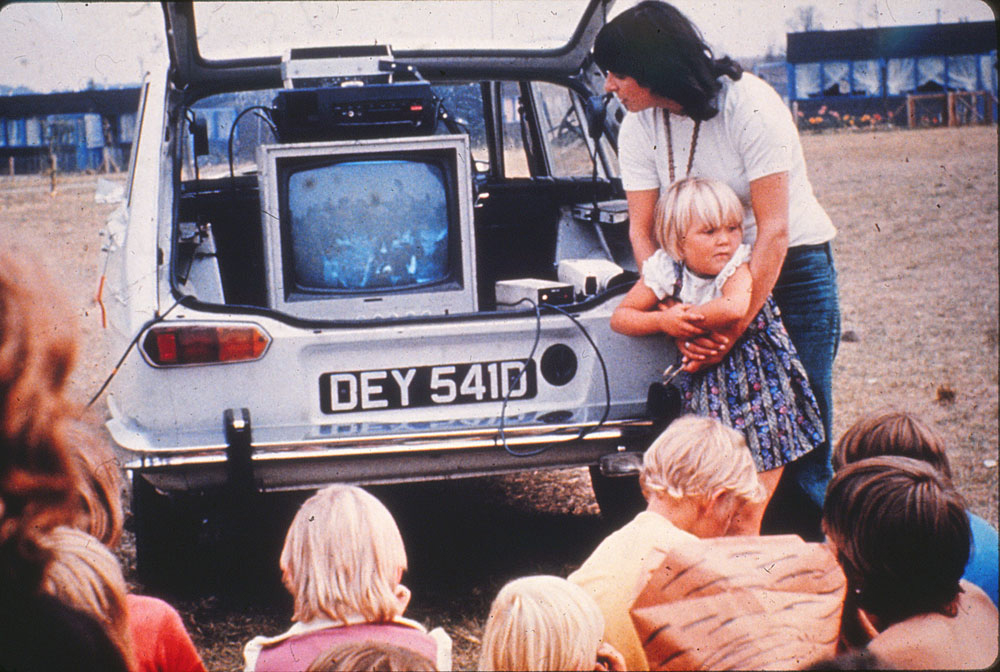 Film still from sweet 16 with children and car