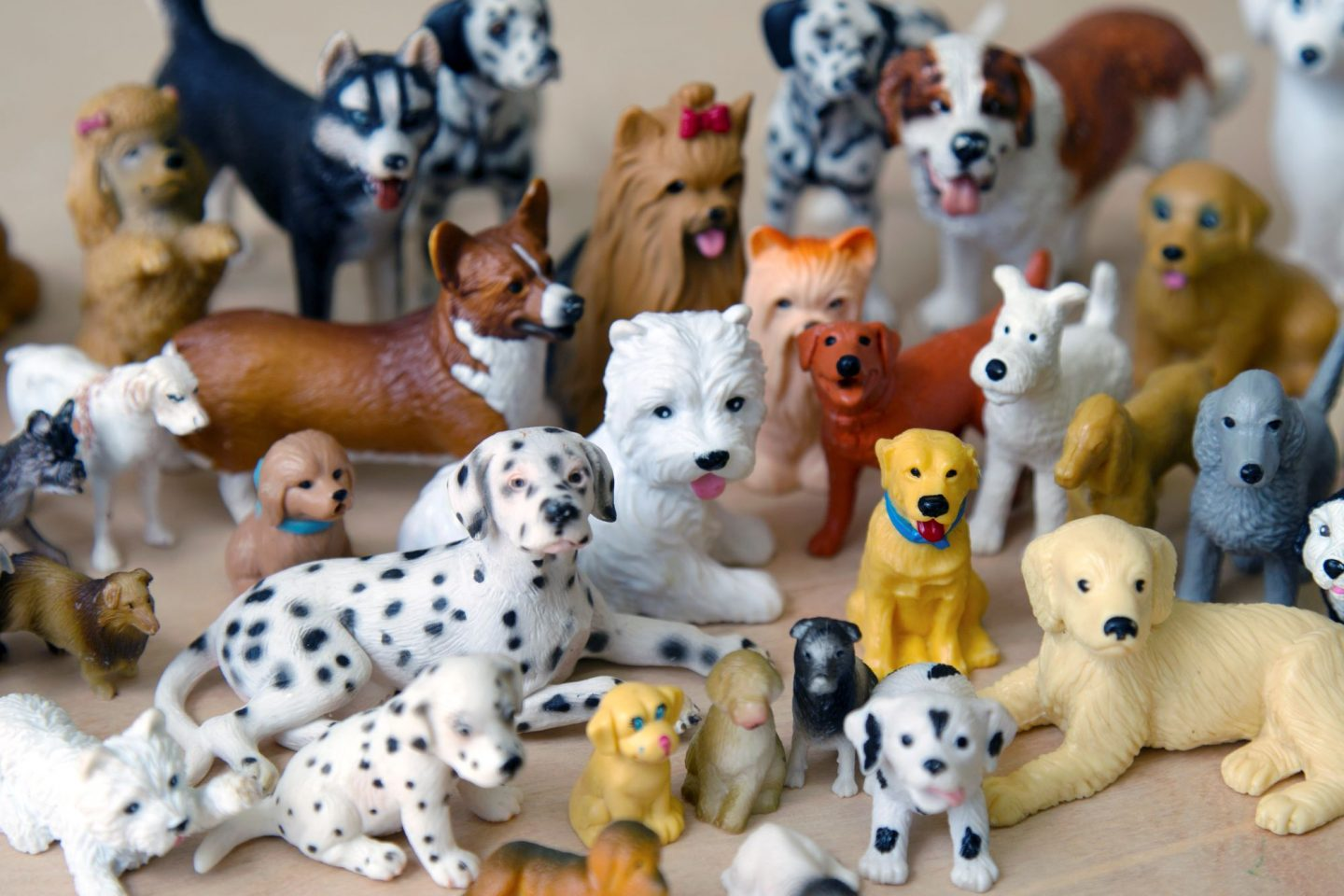Plastic dog figurines arranged as if posing for a family photo