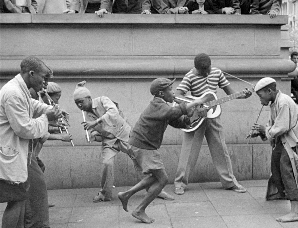 Penny Whistlers and Musicians on the street in the film COME BACK, AFRICA by Lionel Rogosin.