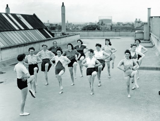 <p>An exercise class on the roof of the Pioneer Health Centre</p>