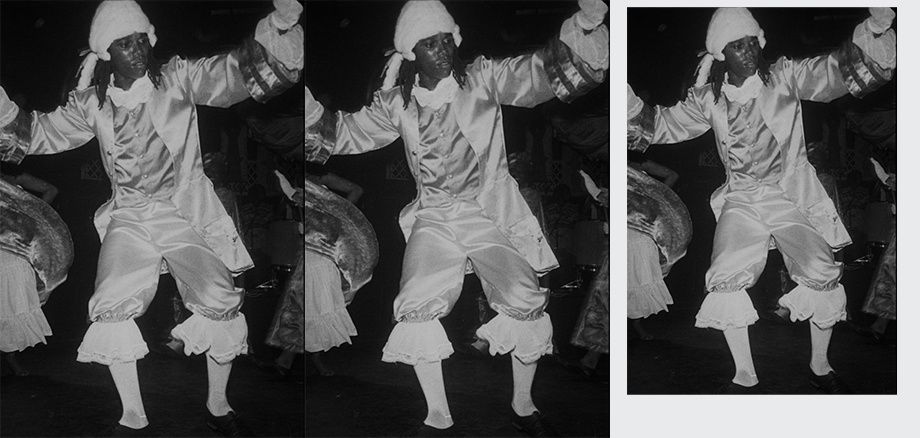 Black and white photo of Curtly Thomas in white shiny frilly clothes and white wig