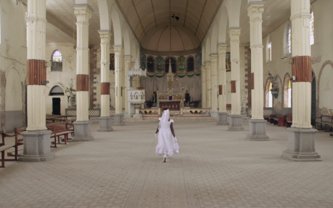 A figure in white stood inside a religious building