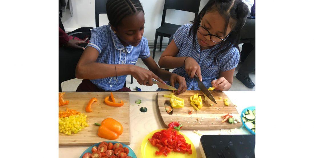 <p>Chopping vegetables at Art Block, 2019</p>