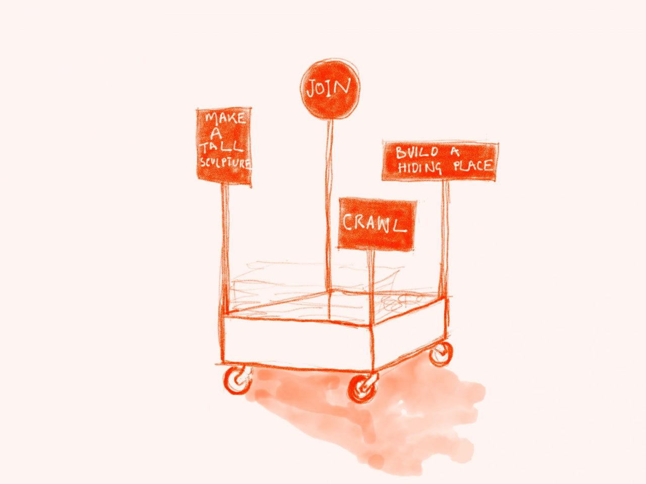 Trolley on wheels with signs saying: 'make a tall sculpture', 'join', 'crawl', 'building a hiding place'