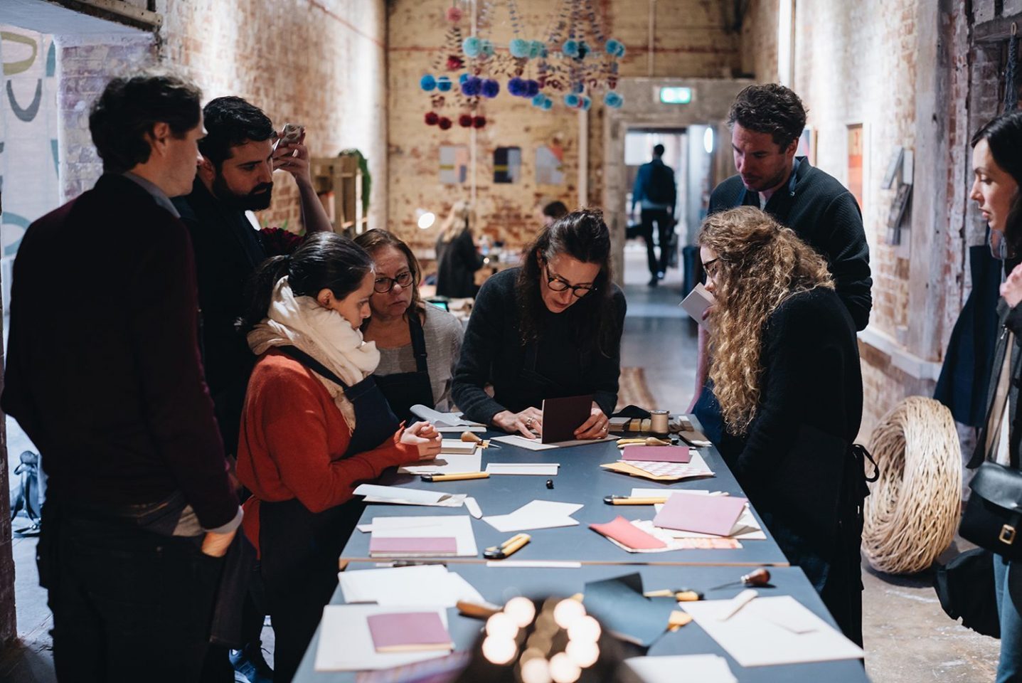 Kate Rochester leads a bookbinding workshop