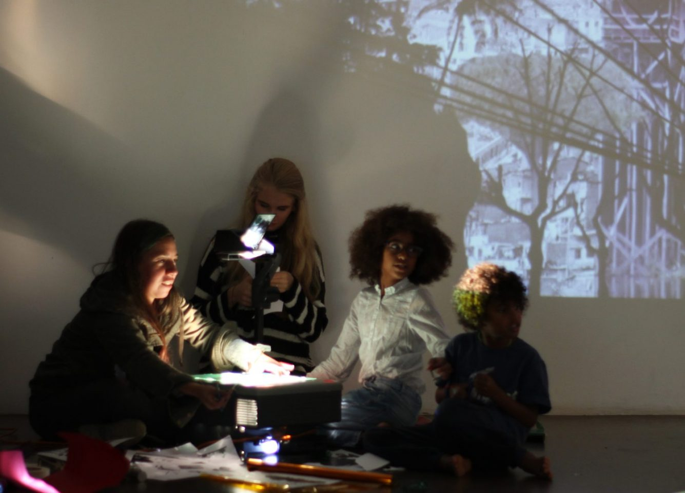 Children in the Clore Studio with a projection behind them