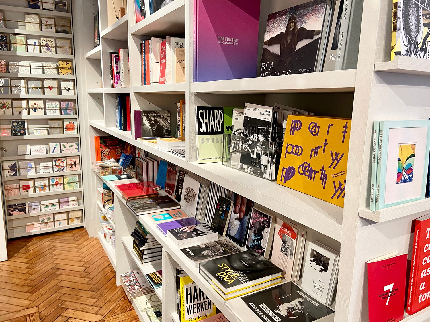 The SLG Bookshop shelves with lots of brightly coloured books