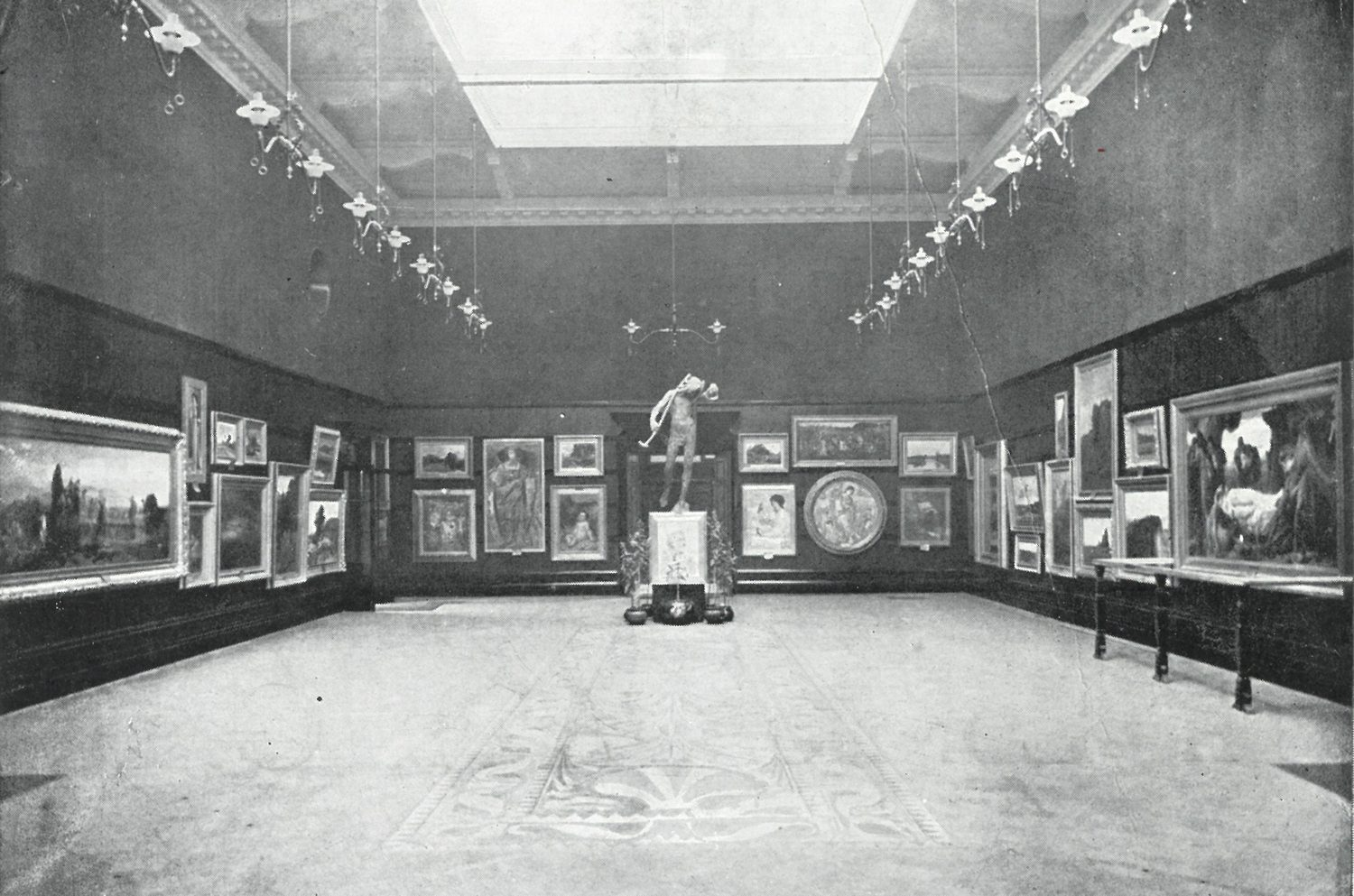 Black and white photograph of the Main Gallery with work on the walls and the marquetry floor visible